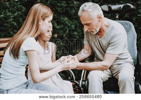 Aged And Family Spend Time Together. Businessman With Child. Family And Old Man On Banch. Wheelchair
