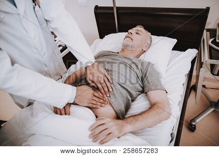 Professional Doctor Help Patient In Clinic. Doctor And Patient In Clinic. Doctor With Patient In Hos