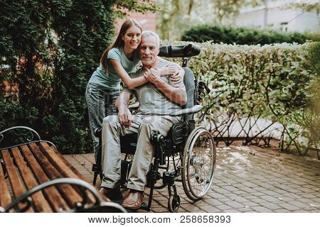 Disease Old Man. Young Girl With Old Man. Businessman And Young Girl On Wheelchair. Happy Family On