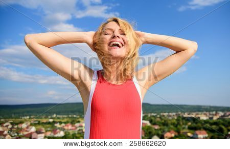 Girl Pleased With Warm Sunlight Looks Relaxed Blue Sky Background. Take Care Skin Armpit. Woman Blon