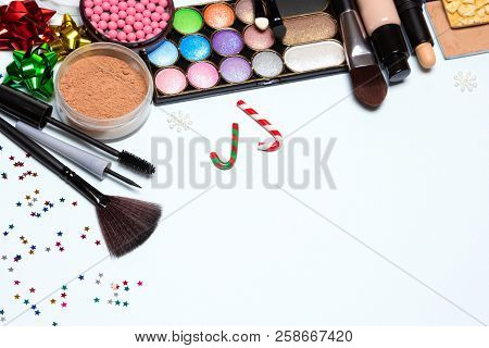 Christmas Party Makeup Background. Bright New Year Make-up. Free Space For Text