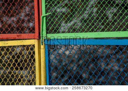 Grunge Texture With Multicolored Metal Mesh Fence Background
