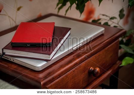 Working Tools Of A Business Person, Notebook, E-book And Laptop