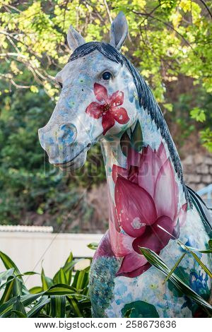 Art Object On The Street, Painted Horse Close-up, With Flowers