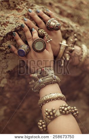 Tribal Style Jewelry On The Hands Of Close-ups, Iron Rings And Bracelets