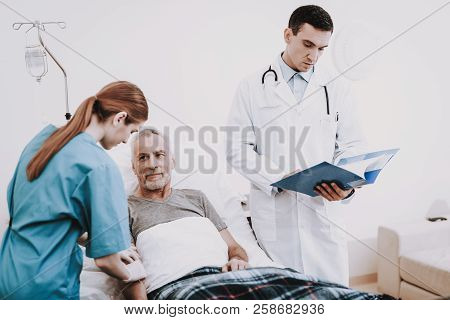 Doctor And Patien In Clinic. Nurse Prick In Vein. Nurse In Clinic. Patient In Hospital. Patient With