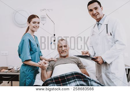 Doctor With Patient In Clinic. Medical Help In Clinic. Young Doctor In Hospital. Nurse In Clinic. Pr