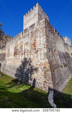 Lisbon, Portugal - February 01, 2017: Castelo de Sao Jorge aka Saint George Castle. Castelejo aka keep with the moat, watchtowers, battlements, ramparts.