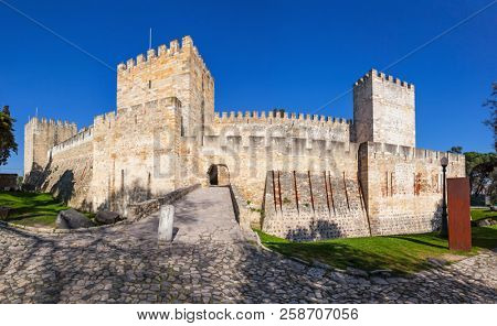 Lisbon, Portugal - February 01, 2017: Castelo de Sao Jorge aka Saint George Castle. Entrance of the Castelejo aka keep with the moat, watchtowers, battlements, ramparts.