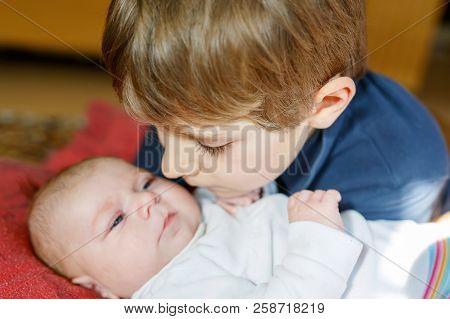 Happy Little Kid Boy With Newborn Baby Sister Girl