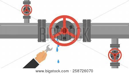 A Man With A Wrench Eliminates The Leak In The Pipe. The Hand Holds A Wrench And Eliminates Leakage