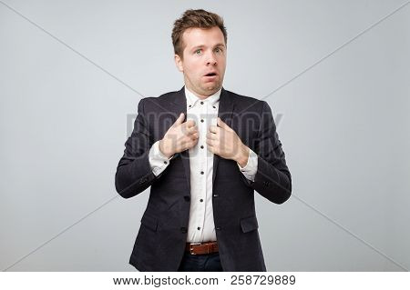 Are You Accusing Me, It Was Not My Fault. Confused Attractive Man In Suit Shrugging And Making Cluel