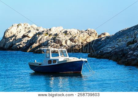 Fishing Boat By The Coast Of Croatia. Fishing Near The Island Of Hvar. Ship In The Bay. Adriatic Sea