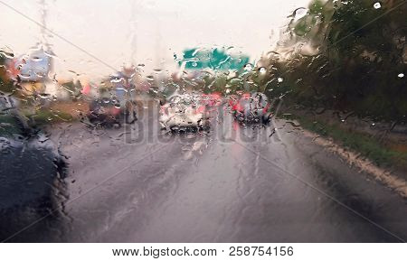 Driving A Car In The Rain Storm