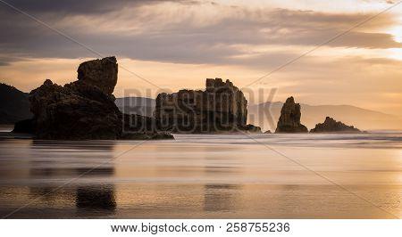 View Of The Beach Of Bayas At Sunset In Asturias, Gijón