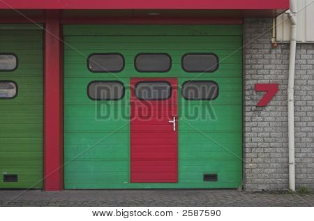 Garage entrance - green and red storehouse door poster
