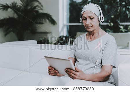 Patient Undergoes Rehabilitation. Cancer Patient On Sofa. Recovering Woman. Remission. Clinic. Cance
