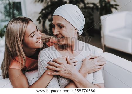 Patient Undergoes Rehabilitation. Cancer Patient On Sofa. Woman With Daughter. Recovering Woman. Rem