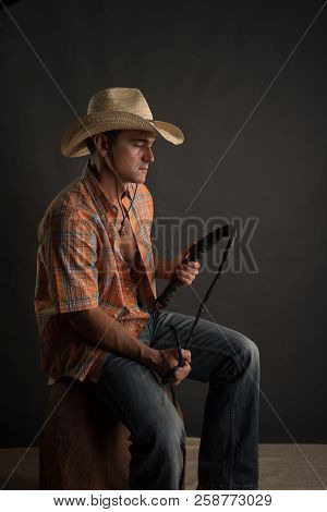 The Sexy Cowboy Prepares For The Rodeo.
