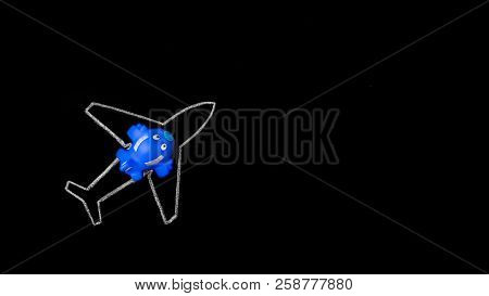 Dream Big. Small Blue Toy Airplane On The Silhouette Of Large Chalk Drawn Airliner On Black Backgrou