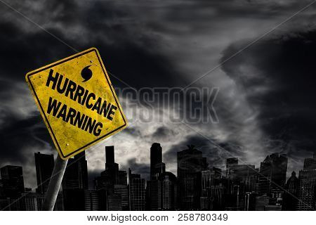 Hurricane Weather Warning Sign Against A Powerful Stormy Background With City Silhouette And Copy Sp