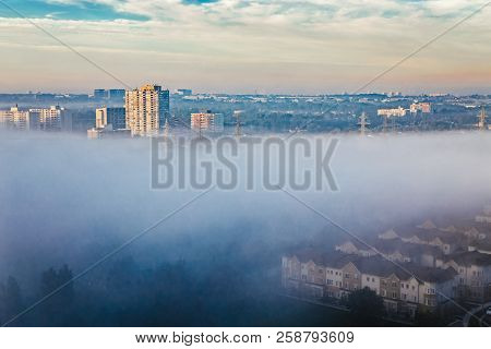Foggy Morning In Toronto City, Canada. Rays Of Early Rising Sun.  Landscape Aerial Top View With Urb