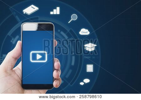 Online Media On Mobile Phone Devices, Hand Holding Mobile Smart Phone And Online Media Application I