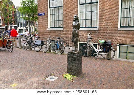 Amsterdam, Netherlands - June 25, 2017: Anne Frank Statue On Westerkerk Plaza Near The Anne Frank Ho