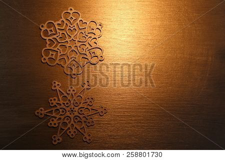 Golden Snowflake Ornaments On Golden Background.  Golden Snowflake Ornaments On Golden Background.