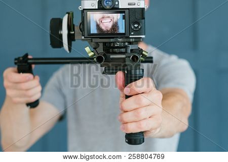 Social Media Influencer Creating Content. Man Shooting Video Of Himself Using Camera. Modern Technol