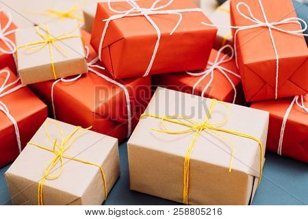 Holiday Presents Packaging And Delivery Business. Mix Of Gifts Wrapped In Red And Craft Paper And Ti