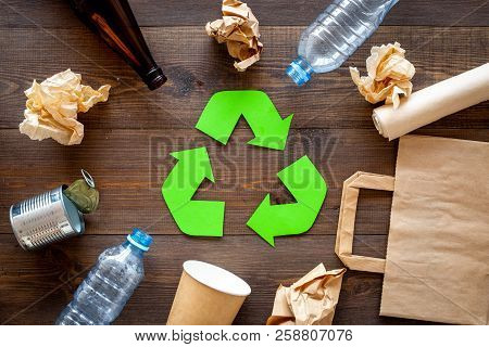 Recycling. Green Recycle Eco Symbol. Recycled Arrows Sign Near Matherials For Recycle And Reuse On D