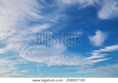 Beautiful Blue Sky Background With Tiny Clouds