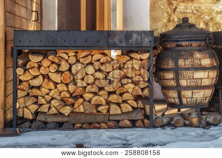 Firewood For The Winter. Firewood For Barbecue. A Background Made Of Wood. Cut And Chopped Logs With