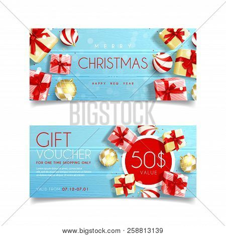 Beautiful Gift Voucher For Christmas. Top View On Realistic Gift Boxes And Christmas Balls On Rustic
