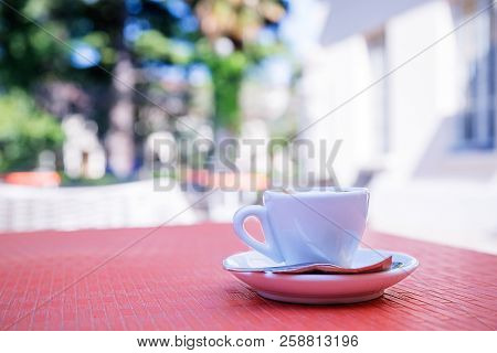 Blurred Background Of Espresso On The Table In The Garden