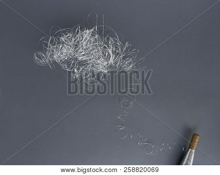 Silver Thread Pile Like Cloud And Spool Of Silver Thread. Pile Of Silver Thread On Grey Background.