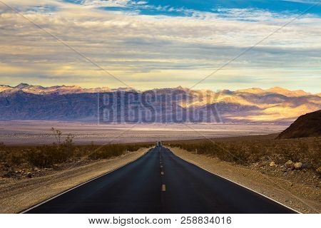 Long Empty Road Running Through Panamint Valley In Death Valley National Park, California