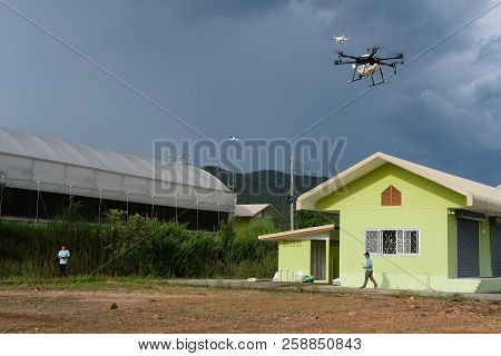Chiang Mai, Thailand - September 7, 2018: Man Flying Agriculture Drone For Spraying Liquid Fertilize