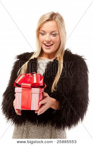Surprised young woman with present