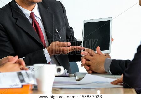 Image Of Team Young Businessmen Using Touchpad At Meeting