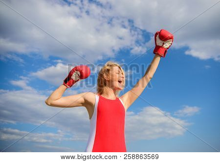 Girls Power Concept. Woman Strong Boxing Gloves Raise Hands Blue Sky Background. Girl Boxing Gloves