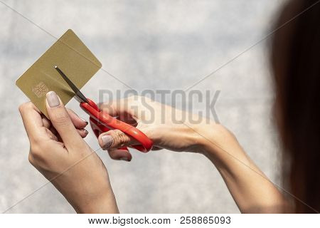 Female Hands Cutting Credit Card With Scissors. Young Woman Destroy Credit Card, Debt Problem Concep