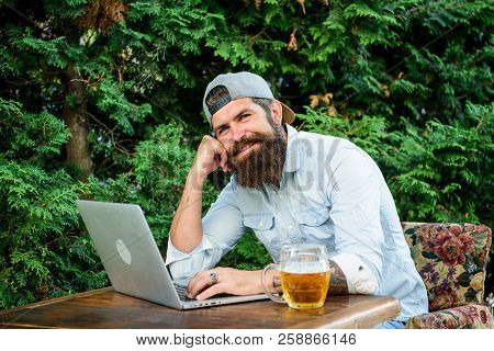 Brutal Man Leisure With Beer And Sport Game. Football Fan Bearded Hipster Make Bet Sport Game Laptop