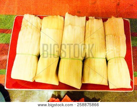 Typical mexican food, ideal for parties and special ocassions. These tamales were part of an offering for the Day of the dead in Mexico. poster