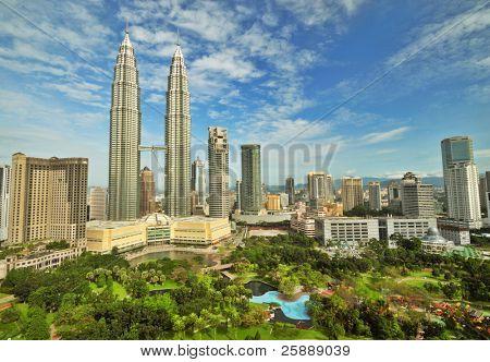 Petronas Twin Towers in Malaysia in Summer Sunny Day. Beautiful Urban View