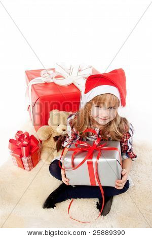 Little girl unwrapping a christmas present