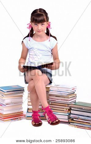 Little girl reading a book sitting among stacks of books isolated on white background poster