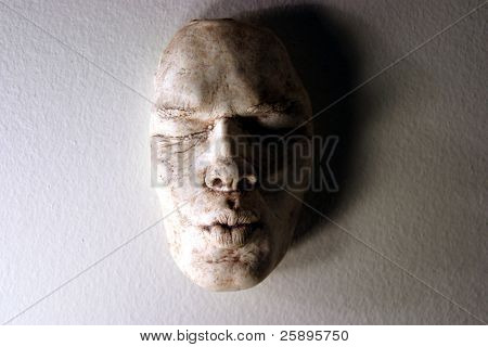 Life Mask, (aka Death Mask) made from a plaster mold of a persons face, then the mold is filled with clay in this case