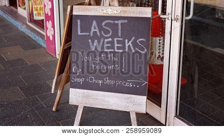 Going Out Of Business Blackboard Sign For City Shop Closing Down Due To Economic Failure